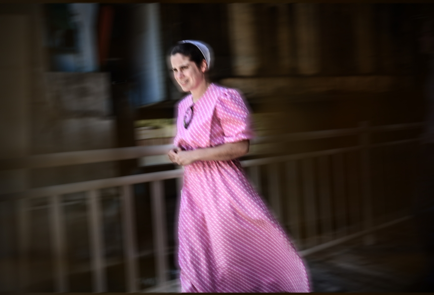 Amish woman in a pink dress